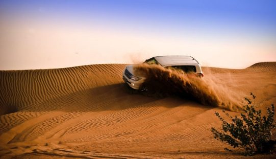 How can one explore the Dubai desert